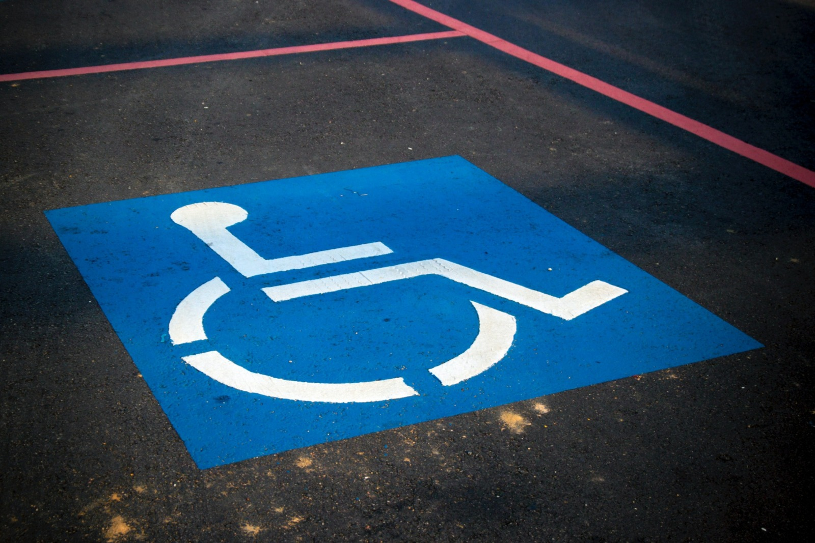 A disabled parking space in a parking lot.